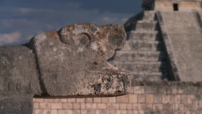 Mayan civilization in Mexico. Dolly shot of ruins Maya pyramids.Ancient Mayan snake eats pyramid