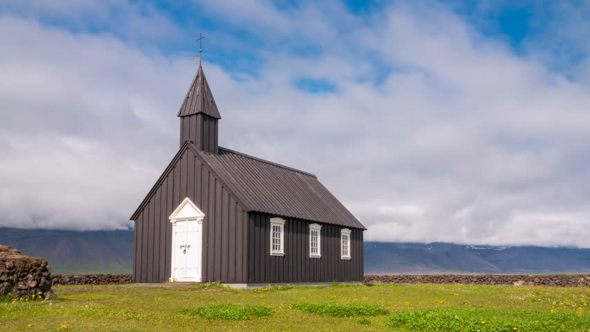 4K Timelapse of black wooden church in front of a mountain range in Budir, Iceland