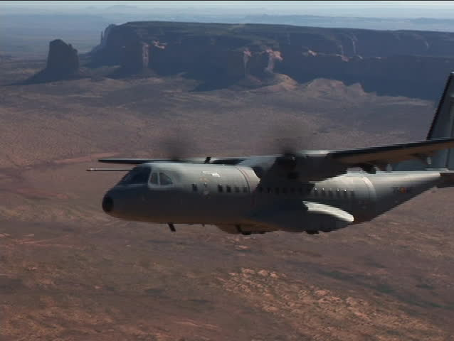 """Low flight near Monument Valley """"Mittens"""".Flying in desert, Lake Powell area. Ground taxi in Casa 295. Casa 295 flying around US, Monument Valley, Moab, Canyonlands, Alaska, in cabin and air to air. - SD stock video clip"""