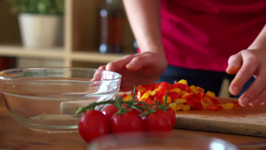 Chopped pepper falling into bowl, super slow motion, shot at 240fps