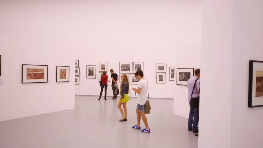 MOSCOW, RUSSIA - AUG 16, 2012: People look at photos at photo exhibition Atomic Civilization in the Multimedia Art Museum.