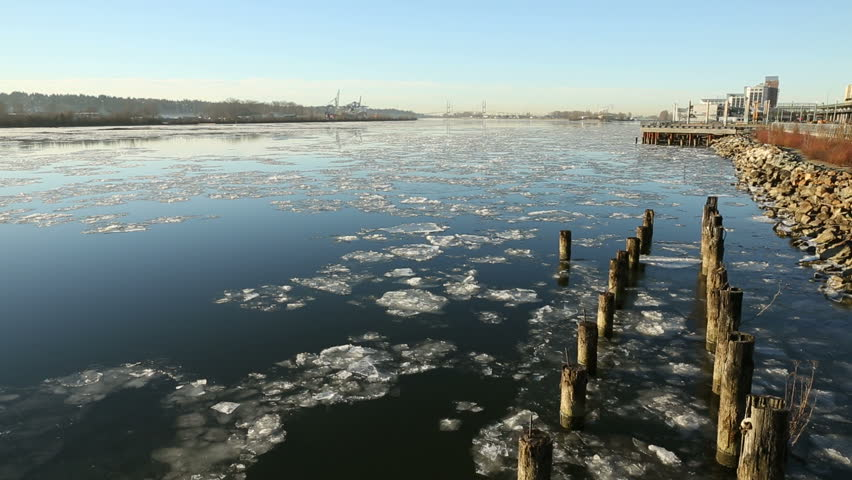 Flowing Fraser River Ice, New Westminster. Chunks of ice on the Fraser River flow past New Westminster, British Columbia, Canada. - HD stock footage clip