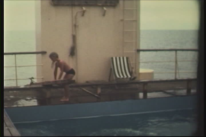 8mm - kids playing in pool on ship. Shot in the 70s. - SD stock footage clip
