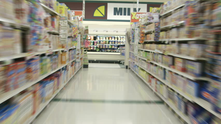 Perspective from a shopping cart as it races through the aisles of a supermarket grocery in time lapse. - HD stock video clip