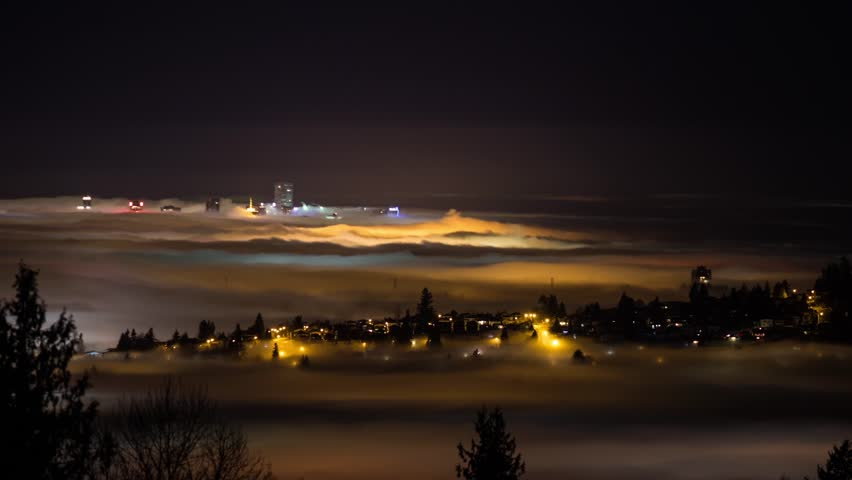 Time lapse of Fog floating above city in Vancouver, BC