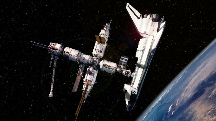The Space Shuttle is docked to the International Space Station (ISS) with a dramatic view of the Earth rotating in the background. Perfect for videos about: The space shuttle program, space shuttles