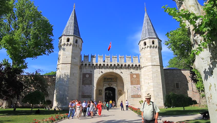 ISTANBUL - MAY 16, 2013: Main entrance into historical Topkapi Palace court also known as Gate of Salutation. It was the primary residence of the Ottoman Sultans for approximately 400 years.