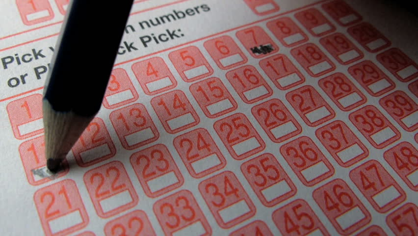Making Prediction By Choosing Numbers On A Lotto Ticket. A Lottery Is A Form Of Gambling Which Involves The Drawing Of Lots For A Prize. 库存影片视频 11199449 - Shutterstock - 웹