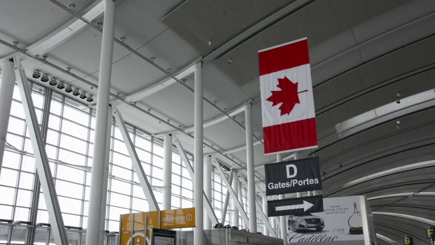 TORONTO,CANADA - MARCH 4, 2014: Indoors at Terminal 1 in Pearson International Airport. One of largest and busiest airport in the world. About 1100 planes take off or land in a day