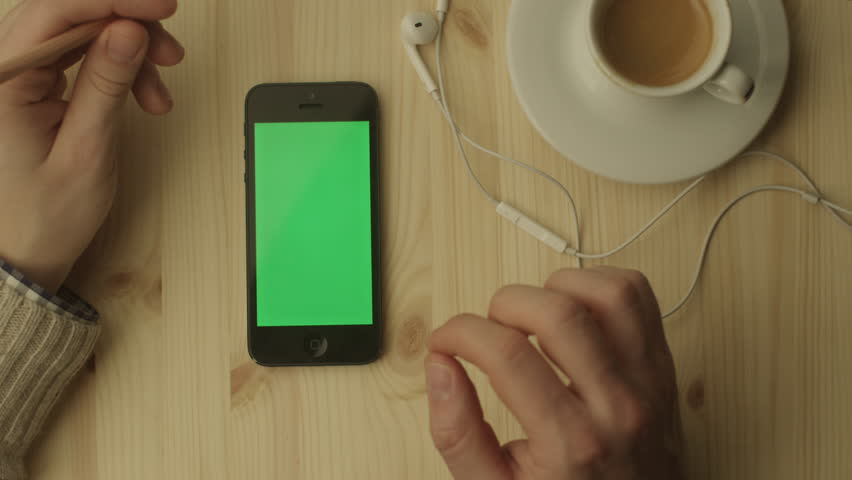 Man Using Phone with Green Screen. Shot on RED Digital Cinema Camera in 4K, so you can easily crop, rotate and zoom, without losing quality. Easy for tracking and keying. ProRes HQ codec.