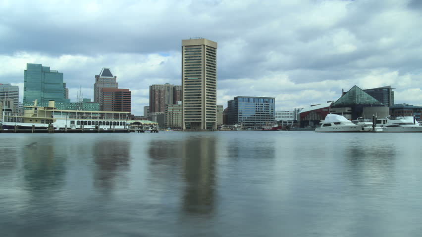 Baltimore, Maryland - March, 2012 - 4k time lapse of Inner Harbor centered on Baltimore World Trade Center on a partly cloudy day.