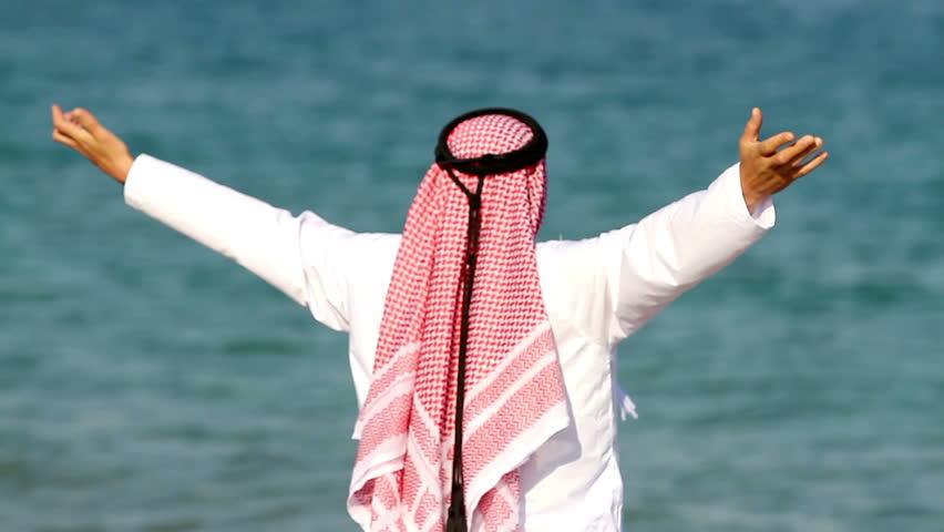 Arabian man,on the beach.Arab man walks along the sea - HD stock video clip