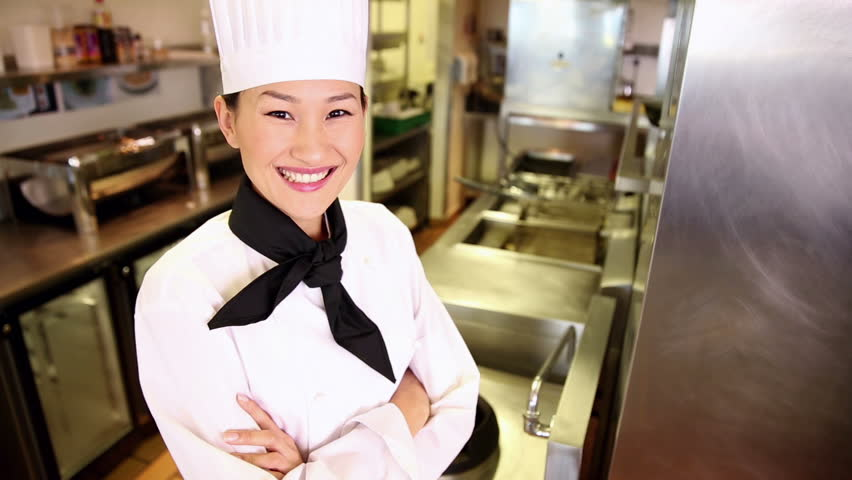 Happy chef smiling at camera in commercial kitchen - HD stock video clip