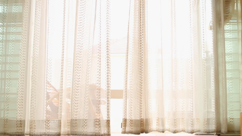Curtains made of seashells moving on the wind stock for White curtains wind