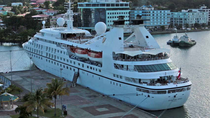 ST THOMAS - JAN 2014:St Lucia cruise ship in harbor marina ready for departure at sunset. Castries. Traffic on urban street. Tourism vital to economy.  Foreign investment, offshore banking and tourism is main revenue.  - HD stock footage clip