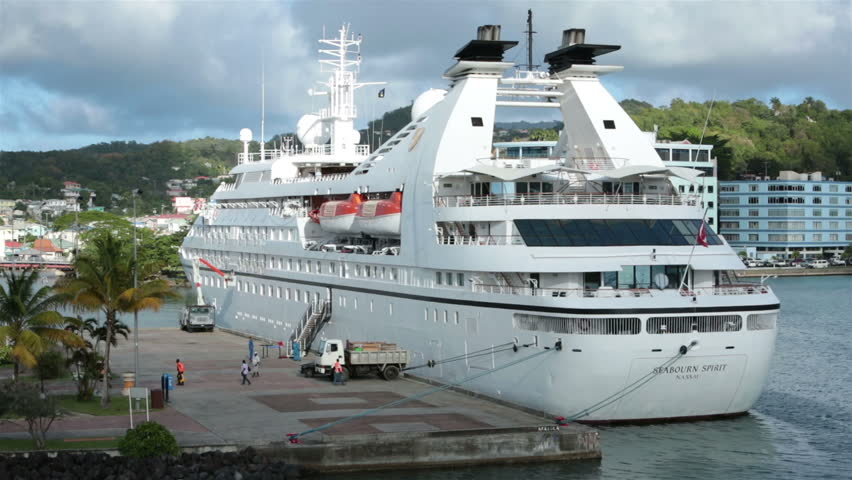 ST THOMAS - JAN 2014:St Lucia Seabourn Spirit cruise ship port loading supplies and cargo for departure. Castries. Foreign business investment in offshore banking, tourism industries is island's main source of revenue.  - HD stock video clip