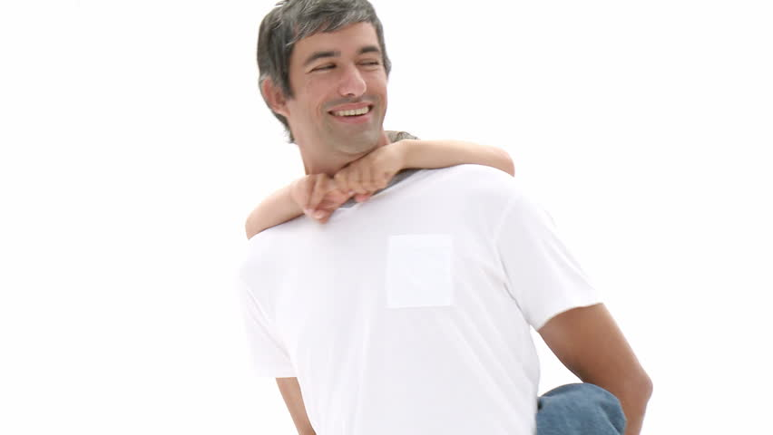 Hgh angle of father giving his son piggyback ride. Footage in high definition