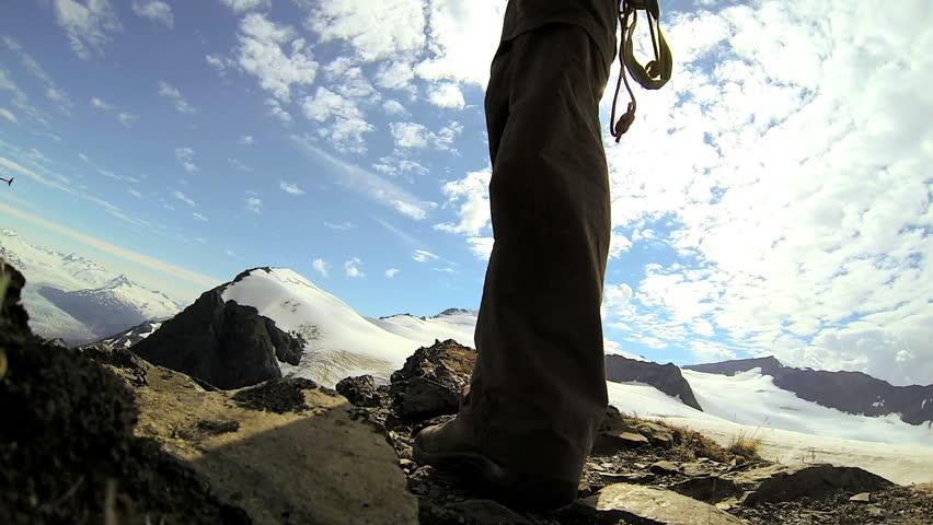 Mountain climber wearing equipment ridge walking Chugach Range of mountains nr Troublesome Glacier, State of Alaska, USA - Mountain climber wearing equipment ridge walking, Alaska, USA