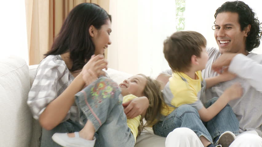 Footage in high definition of happy family playing on the sofa - HD stock video clip