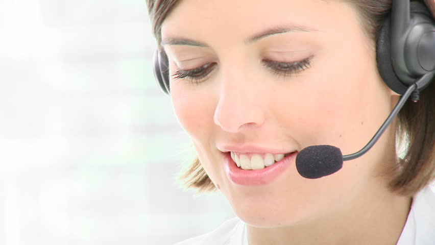 Close-up of smiling beautiful woman working in a call center. Footage in high definition  - HD stock video clip