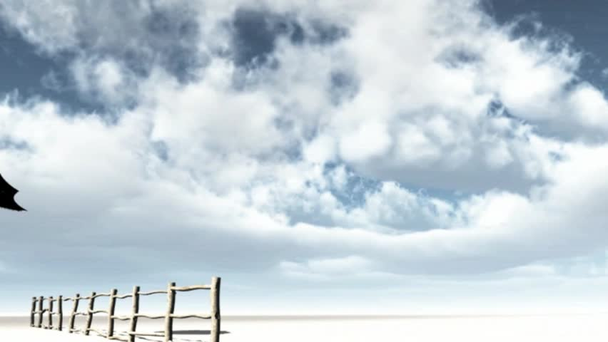 Windy day umbrella turned inside out fly  over a wooden fence across the sand and big blue and white cloudy sky
