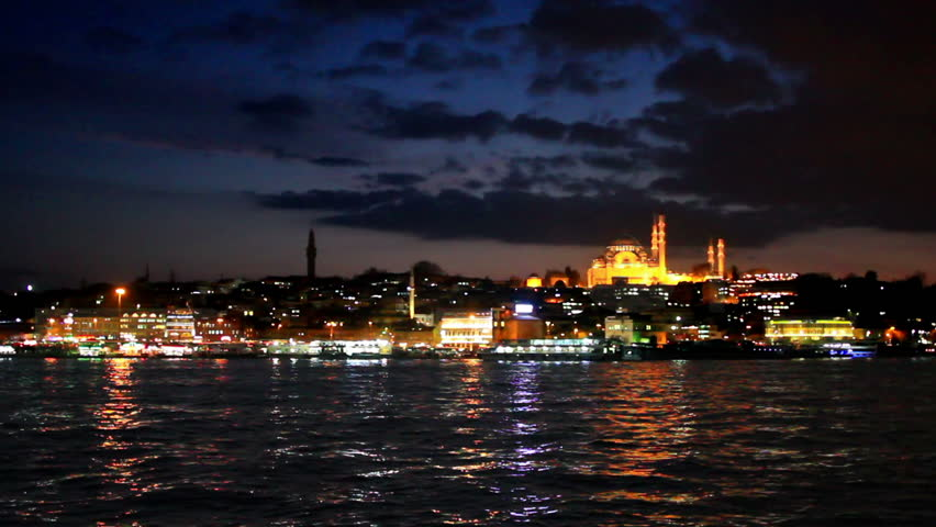 Eventide at Goldenhorn. Looking over Golden Horn to old Istanbul, in distance famous landmarks such as Suleymaniye Mosque, Beyazit Tower and Eminonu motor port.