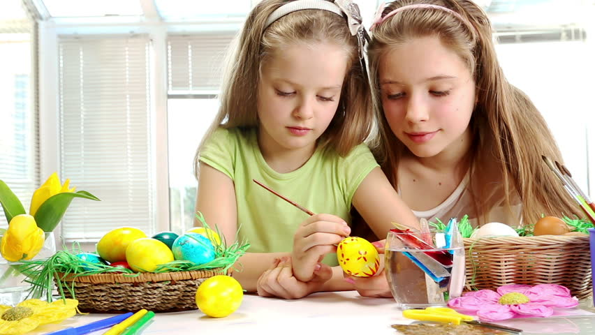 Children paint Easter eggs at home. - HD stock footage clip