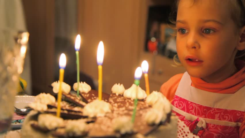 little girl blowing out candles on cake  - HD stock footage clip