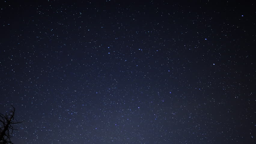 4K Time Lapse of Starry Sky over Alpine Forest -Zooom Out-