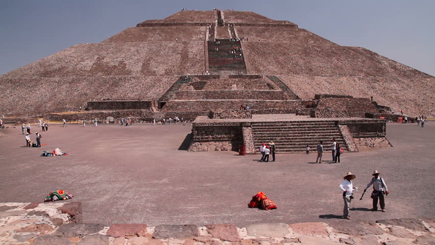Ancient Maya civilization - pyramids in Mexico. Dolly shot of the pyramid of the sun, old stones in the foreground.  Teotihuacan