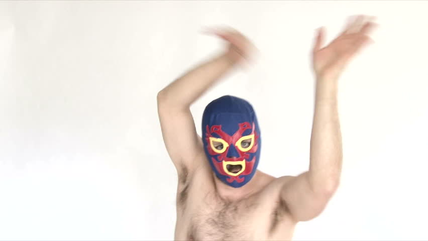 Model released man in studio wearing blue lucha libre mask showing off ridiculous skills. - HD stock footage clip