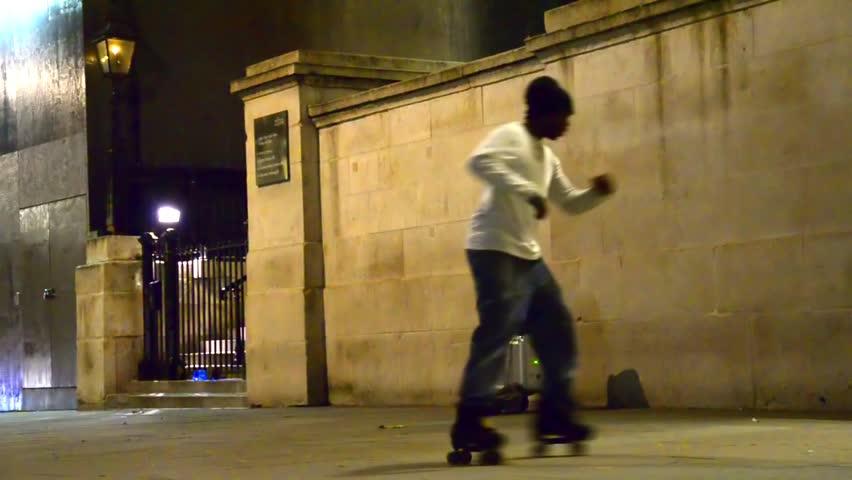 LONDON circa DEC, 2013: London street roller skate dancer at Trafalgar square in circa December,2013 in London.Skilled street performer do roller dance