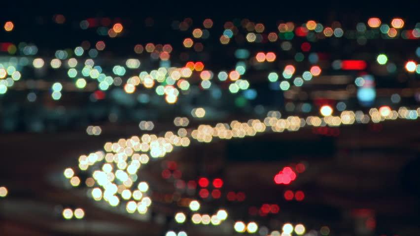 Soft focus on lights of city night traffic