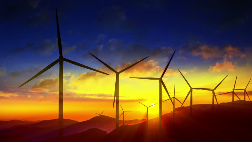 4K Beautiful windmill turbines harnessing clean, green, wind energy silhouetted in the sunrise/sunset sky with sun rays. Green energy. HD Version - 4K stock footage clip