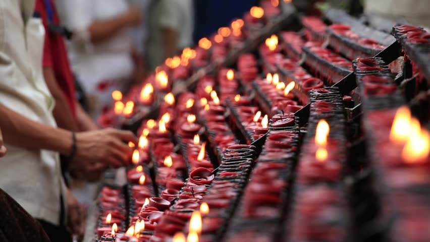 CEBU, PHILIPPINES - MARCH 14, 2014 : Unidentified people lit of candles in a old Catholic Church of the Basilica del Santo Niño in the Cebu, Philippines - HD stock video clip