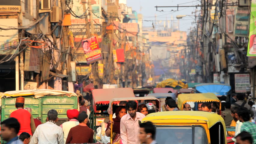 INDIA - DECEMBER 2012: Vehicles and people at the busy Chandni Chowk market Old Delhi, India, Asia