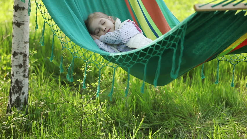 Little girl sleeping in a hammock - HD stock video clip