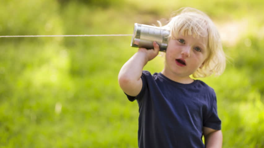 Boy using a string can phone