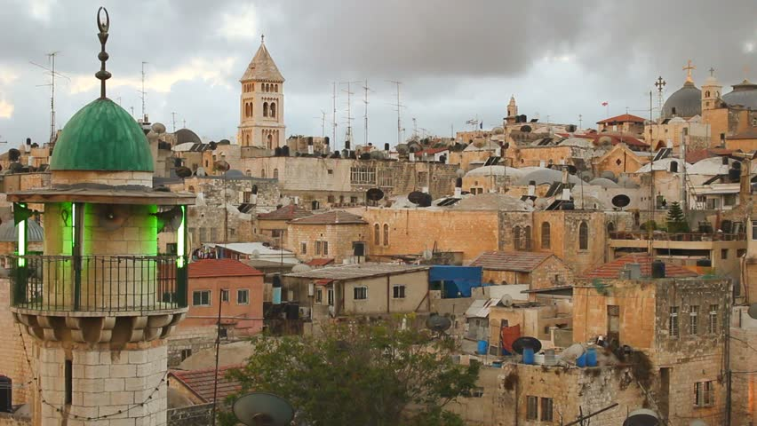 JERUSALEM, ISRAEL CIRCA 2013 - Mosques, churches and synagogues line the skyline across a neighborhood in the Old City of Jerusalem, israel.