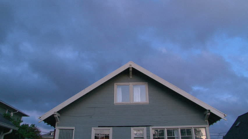 Sunrise over house with lights turning on and off.