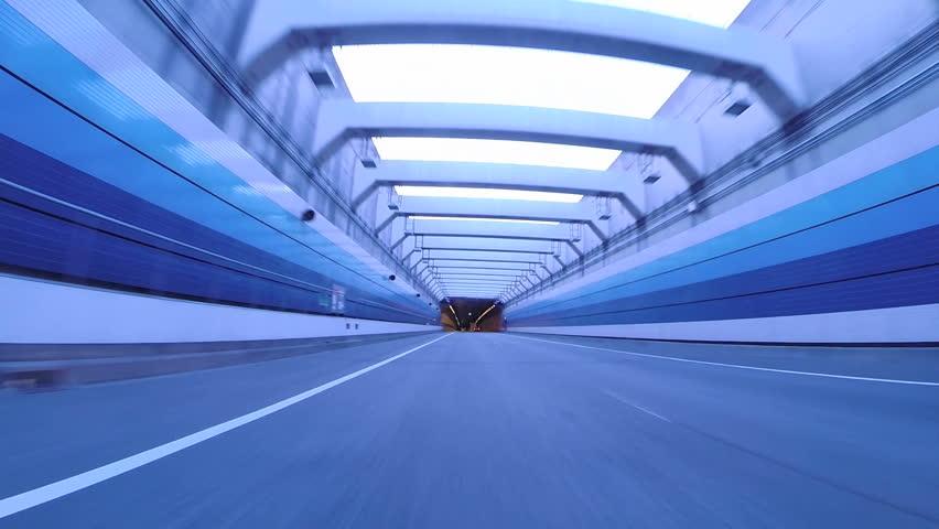 Twilight drive through Tokyo Bay Area's futuristic structures.