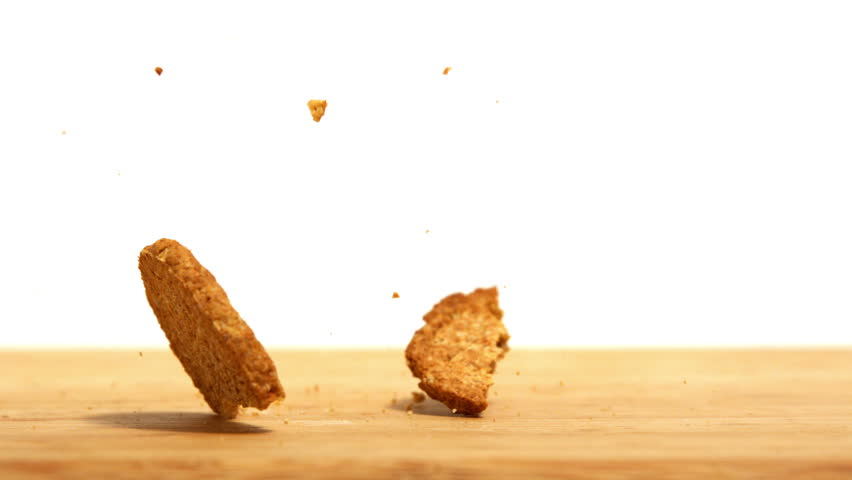Biscuit breaking on wooden table in slow motion - HD stock footage clip