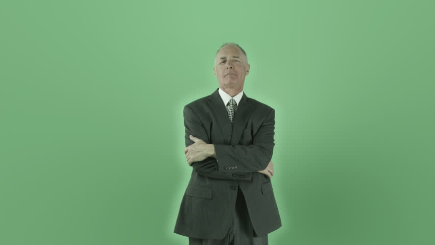 Senior caucasian businessman isolated on chroma green screen confident smiling - 4K stock footage clip