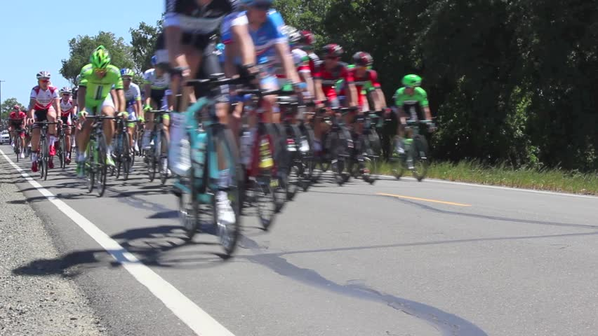 CYCLING RACE AMGEN TOUR OF CALIFORNIA STAGE 1 May 11, 2014. STARTS IN SACRAMENTO, CA. CYCLING TEAMS BATTLE THE 108 MILE COURSE ON A WINDY DAY. HD VIDEO OF PELOTON MILE 8. NEWS EDITORIAL  No Release