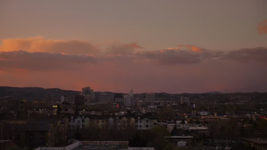 Reno, Nevada - March, 2014 - Wide shot of the sun setting over downtown Reno.