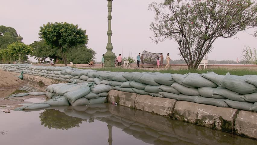 Southeast asia , Cambodia, Mekong river,  october 2013.   Pile of sand bags on the flooded street.   Sandbags used as flood barrier