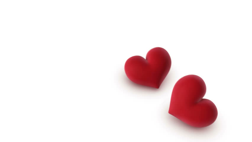 two hearts falling onto a white background - 3d animation