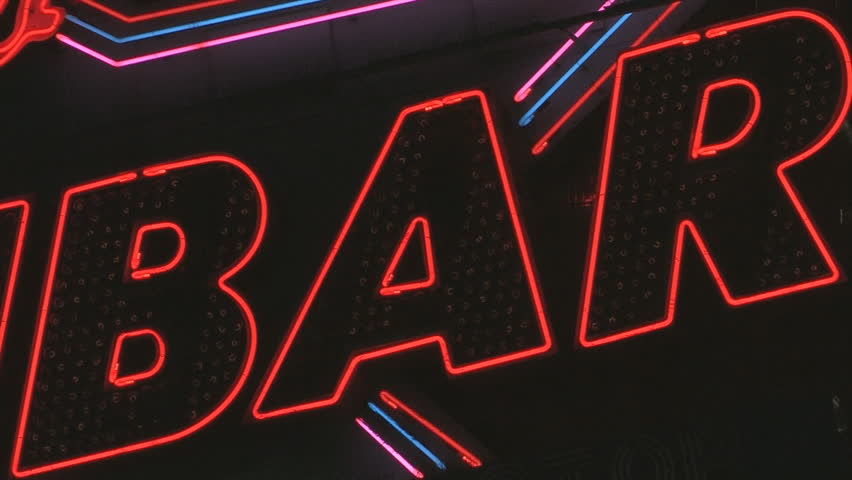 "BAR sign. Red and white flashing sign reading ""BAR"". Neon and lightbulbs. Shot with Canon XH-A1s."