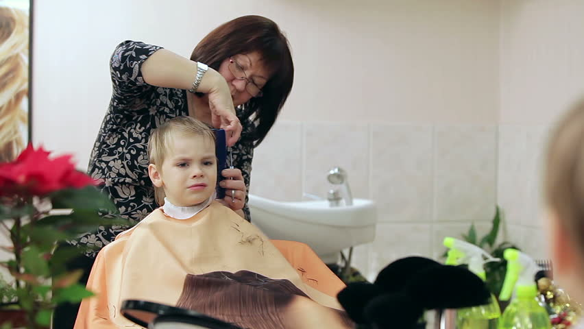New Hairstyle For Blond Boy This Cute Little Boy Is Enjoying Himself At Barbers Shop Lady
