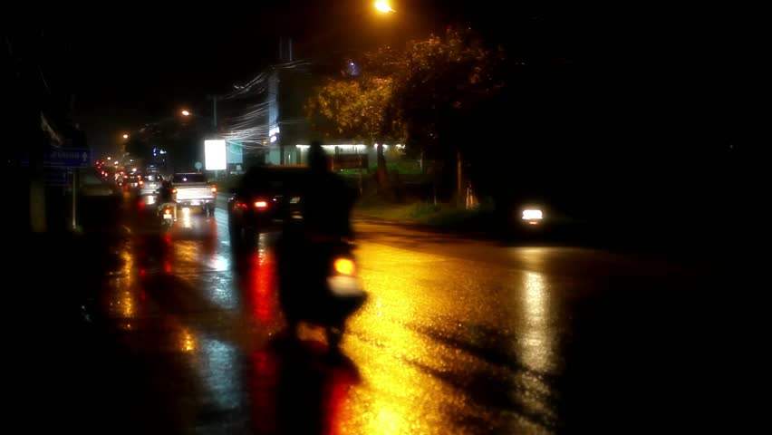 cars and motorbikes driving on a wet road at night after rain video stock footage video 6648425. Black Bedroom Furniture Sets. Home Design Ideas